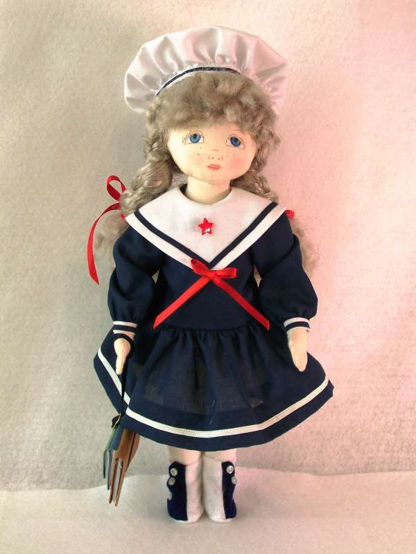 Pollyanna wearing a sailor dress
